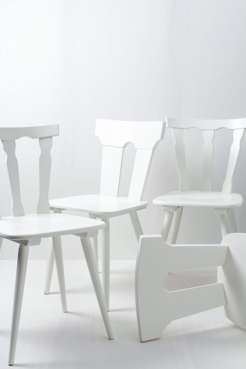 These vintage mismatching wooden chairs enhance any table setting. Their individual shapes and designs create a unique but striking picture at your party, wedding or event. The chairs are lacquered in white silk matt.