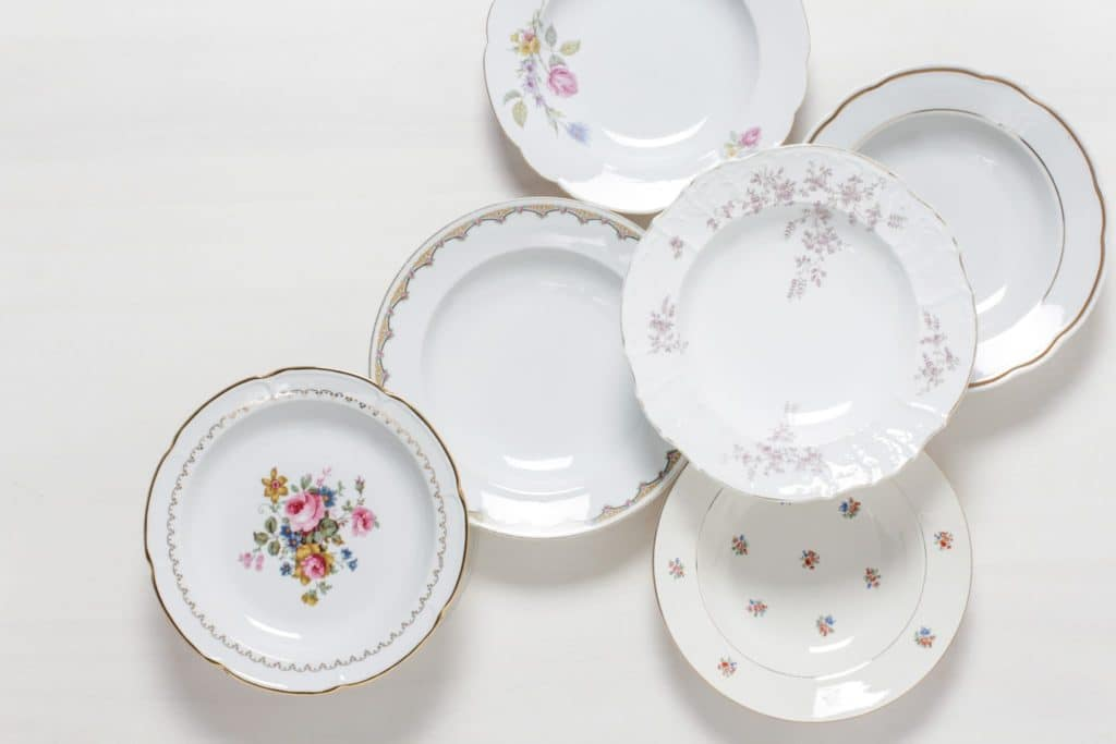 Soup Plate Carmen Mismatching Floral   Dining together at a long table is an important part of the celebration. Family style lunches or dinners are especially cosy when the food is served in large, steaming bowls.The romantic soup plates are selected at random in a mismatching look. Flower patterns in delicate colours, petite shapes and sparkling gold make each plate an unmistakable unique piece. Each soup plate conjures up an individual vintage charm on the laid table - as if directly from the flea market. Vases full of wildflowers, antique silver cutlery and softly falling tablecloths also look great. The soup plates are excellent for serving a wild herb salad as well.Matching the soup plates, we offer a selection of vintage food plates, sauces and terrines with decor in the matching style.   gotvintage Rental & Event Design
