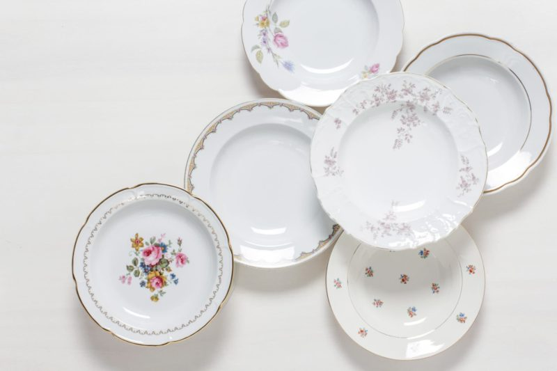 Soup Plate Carmen Mismatching Floral | Dining together at a long table is an important part of the celebration. Family style lunches or dinners are especially cosy when the food is served in large, steaming bowls. The romantic soup plates are selected at random in a mismatching look. Flower patterns in delicate colours, petite shapes and sparkling gold make each plate an unmistakable unique piece. Each soup plate conjures up an individual vintage charm on the laid table - as if directly from the flea market. Vases full of wildflowers, antique silver cutlery and softly falling tablecloths also look great. The soup plates are excellent for serving a wild herb salad as well. Matching the soup plates, we offer a selection of vintage food plates, sauces and terrines with decor in the matching style. | gotvintage Rental & Event Design