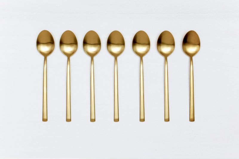 Table Spoon Ines Cutlery Gold Matt | With the cutlery series Ines we rent out wonderful, matt-gold stainless steel cutlery. The cutlery has a wonderful haptic and looks equally good for different types of events. Whether on a colourful table setting combined with strong colours, an elegant, minimalistic wedding or a stylish business dinner - our matt gold cutlery Ines is an excellent choice for your event. Rent the table spoon Ines to delight your guests with the special cutlery. Matching the matt gold table spoon Ines, we also offer starter forks, starter knives, dinner forks and knives, as well as teaspoons and last but not least, cake shovels, serving spoons and butter shovels for rent. | gotvintage Rental & Event Design