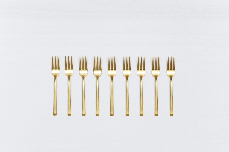 Cake Fork Ines Cutlery Gold Matt | With the cutlery series Ines we rent out wonderful, matt-gold stainless steel cutlery. The cutlery has a wonderful haptic and looks equally good for different types of events. Whether on a colourful table setting combined with strong colours, an elegant, minimalistic wedding or a stylish business dinner - our matt gold cutlery Ines is an excellent choice for your event. Hire the cake fork Ines to delight your guests with the special cutlery. The cake fork makes a great dessert fork as well. Matching the matt gold cake forks Ines, we also offer teaspoons, cake shovels, espresso spoons and vintage tableware for rent. | gotvintage Rental & Event Design