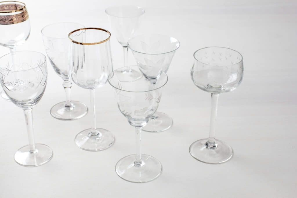 Wine Glass Patricia Mismatching   Vintage wine glasses with various patterns and shapes, some are adorned with golden rims.   gotvintage Rental & Event Design