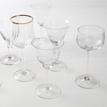 Wine Glass Patricia Mismatching | Vintage wine glasses with various patterns and shapes, some are adorned with golden rims. | gotvintage Rental & Event Design