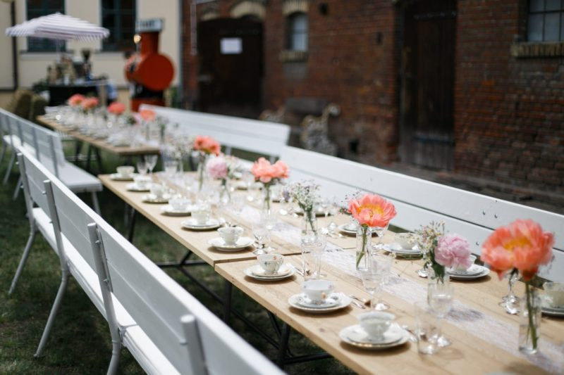 Rent a wooden bench for seating area and wedding table
