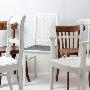 Wooden Dining Chairs Laura White & Brown Mismatching | With these vintage mismatching wooden chairs you can decorate any table. Through the individual shapes and designs, the different shades, in brown and white, results a unique but striking picture at your party, wedding or event. Up to 350 mismatching wooden chairs are available, allowing a long table to be beautifully designed. | gotvintage Rental & Event Design