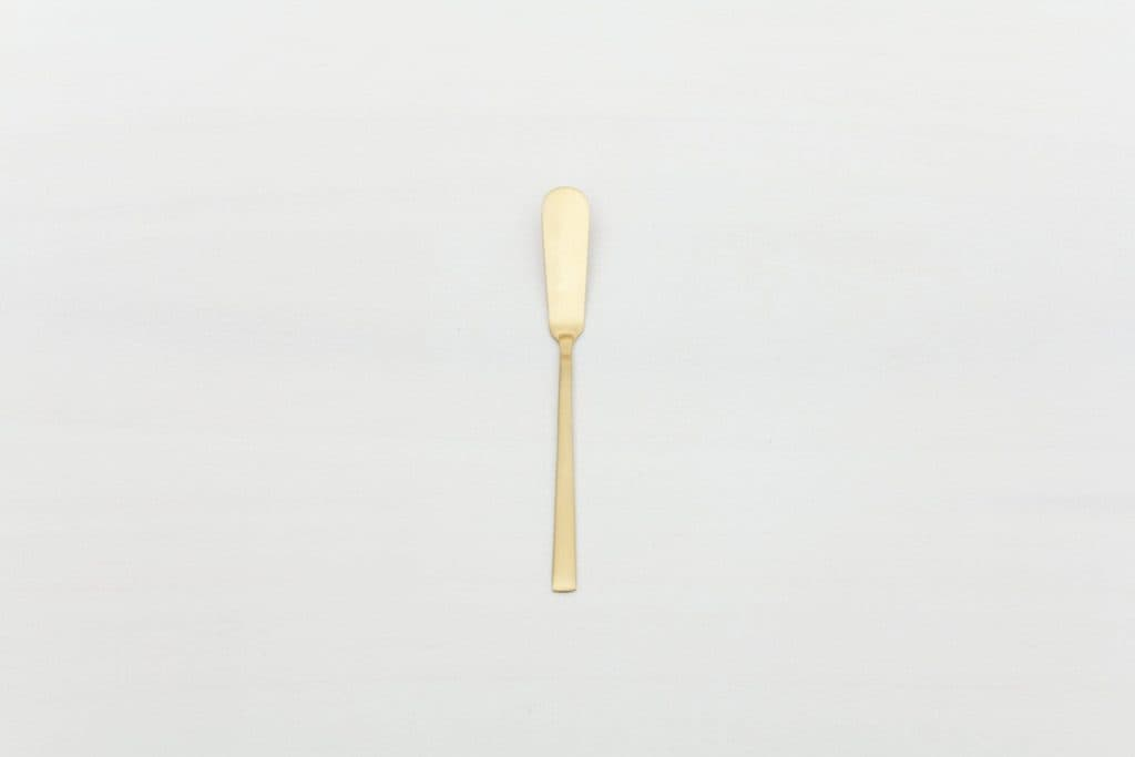 Butter Knife Ines Cutlery Gold Matt | Matte golden PVD-coated stainless steel butter knife of classic design and with a nice look and feel. Matching cake server, starter fork, starter knife, table spoon, dessert fork and tea spoon available as well. | gotvintage Rental & Event Design