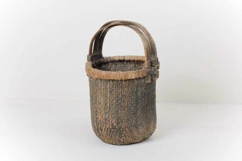 Chinese Antique Basket Amado | Beautiful woven baskets from China. The design of the baskets' woven pattern and the crisscross of the wooden handles make these baskets special. They look great and they can be functional in many ways. | gotvintage Rental & Event Design