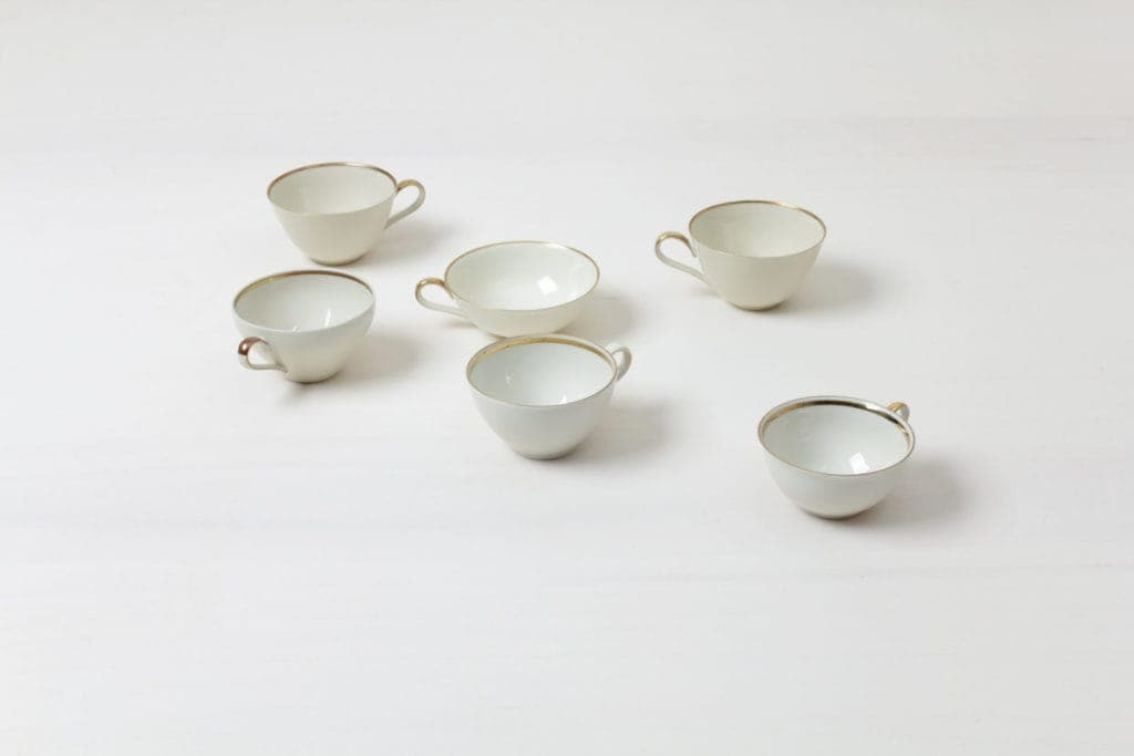 Cup Magdalena Ivory Colored   Elegant ivory coloured cups with gold rim. Mismatching though almost matching, curated out of German porcelain from the 1930s to the 1960s.   gotvintage Rental & Event Design
