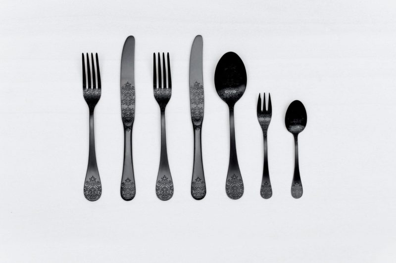 Cutlery Set Natalio Black Matte 7-pieces PVD | Matte black cutlery with a nice feel. Set consisting of two forks, two knives, one table spoon, one dessert fork and one tea spoon. Matching cake server available for rent as well. | gotvintage Rental & Event Design