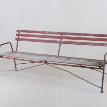 Red wooden garden bench in vintage style for rent