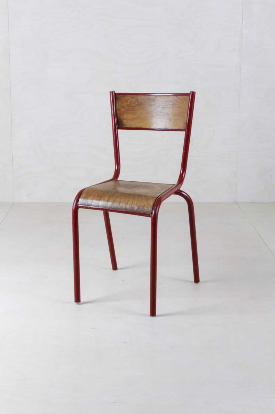 Tubular Steel Chair Salazar Red | This Mullca 510 vintage chair could be found in French schools, dating back to the 1960s. A great patina shows its history.Tubular steel chair saved out of a French class room.Up to 140 pieces available, in different colours and conditions: you definitely can see they are not straight out of a factory. | gotvintage Rental & Event Design