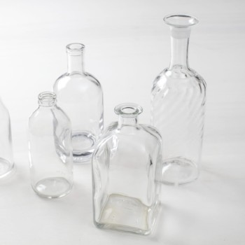 Glass Bottles Lucia | Mismatching glass bottles, clear, both with and without patterns. | gotvintage Rental & Event Design