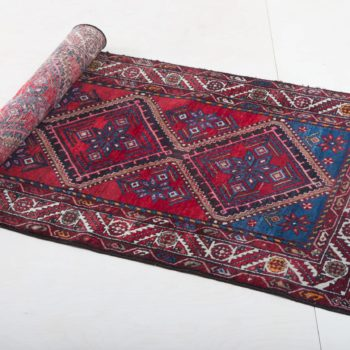 Carpet Hipolito | Ever wanted to walk the red carpet? That's no problem on this three-meter long treasure. From a grand entrance for a bridal couple or guest of honour, to a cosy seating area at a garden picnic, this long red vintage carpet with its antique oriental elements can be used in many ways. 