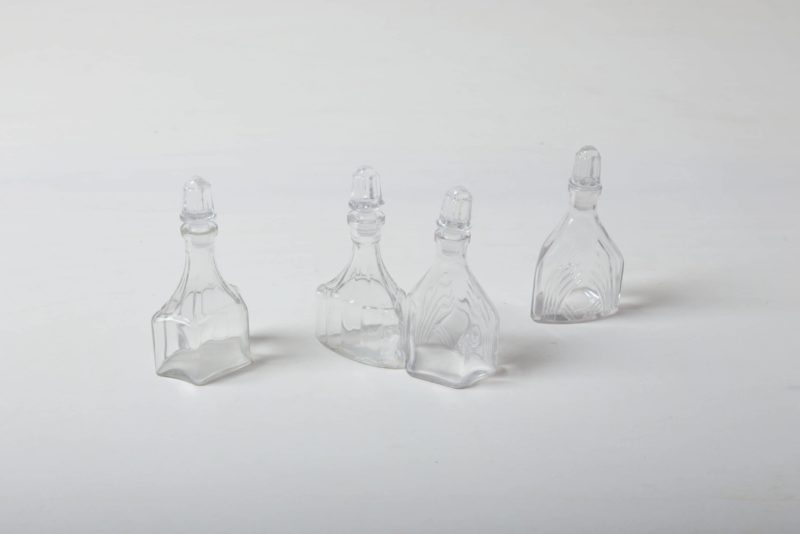 Crystal Glass Bottles Abital | In the past, vinegar and oil were served in these romantic crystal carafes. In their new lives these small flasks still look great on the table; they now serve as vases for meadow flowers and elegant grass leaves. It doesn't matter if placed individually or in groups.The crystal bottles go very well with our larger crystal carafes and bowls | gotvintage Rental & Event Design