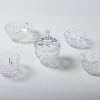 Sugar Bowl Beatrisa Crystal | Our sugar bowls made of sparkling crystal glass with sophisticated ornaments are a beautiful eye-catcher on the coffee table. They are not only perfect for loose sugar and sugar cubes, but also for small sweets such as chocolate mocha beans, pralines or macarons.Alongside the sugar bowls we offer matching milk and cream jugs and crystal glass vases and bowls. | gotvintage Rental & Event Design