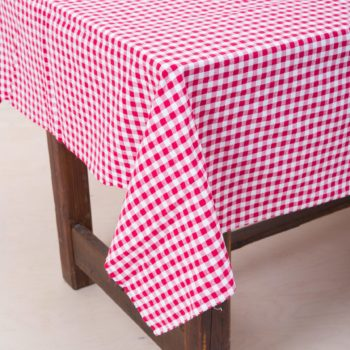 Tablecloth Loma | With its red and white checked pattern with little hearts in the middle, this pretty tablecloth is a good fit just about anywhere. By putting several together, a long table can be transformed into a happy table for celebrating with friends and family. Many individual, small tables with romantic checkered ceilings create a harmonious bistro atmosphere. Perfect for finalising the table setting are our vintage tableware, Antonia silver cutlery and Patricia vintage glasses. All series are mismatched, but together they create a unique decoration in the truest sense of the word. Tablecloth per meter, not B1 certified. Without cleaning costs. | gotvintage Rental & Event Design