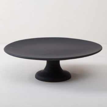 Cake Stand Ernesta Matt Black XL | Our large round elevated cake stand Ernesta rests on a 15 cm high foot and has a diameter of 40 cm. On the matt black serving tray there is enough space to present and arrange cakes, cupcakes, sushi and other delicious food on the table or at the modern buffet. The serving trays are handcrafted from high-quality terracotta and glazed matt black, obviously food safe. These cake stands are available in three different sizes as well as a matt white serving tray. They can be wonderfully combined for presentations. | gotvintage Rental & Event Design