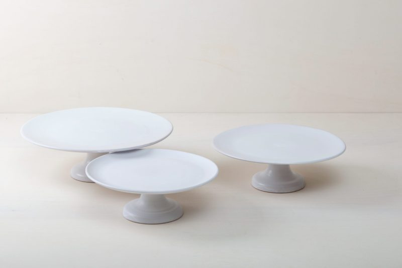   Our medium size elevated cake stand Ernesta rests on a 13 cm high foot and has a diameter of 35 cm. Enough space to present and serve cakes, cupcakes, sushi and other delicious food on the table or at the modern buffet. The serving trays are handcrafted from high-quality terracotta and glazed matt white, of course food safe.These cake stands are available in three different sizes as well as a matt black serving plate. They can be wonderfully combined for presentations.  