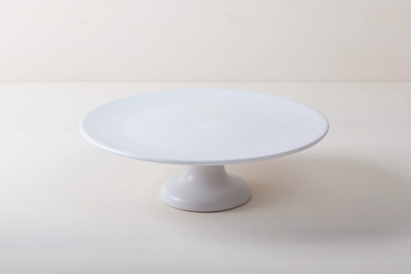   Our large round elevated cake stand Ernesta rests on a 15 cm high foot and has a diameter of 40 cm. Enough space to present and serve cakes, cupcakes, sushi and other delicious food on the table or at the modern buffet. The serving trays are handcrafted from high-quality terracotta and glazed matt white, of course food safe.These cake stands are available in three different sizes as well as a matt black serving plate. They can be wonderfully combined for presentations.  