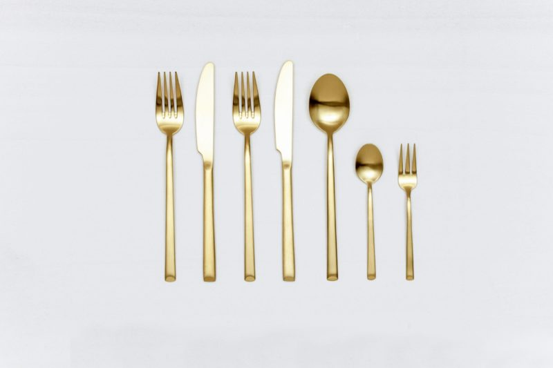 Cutlery Set Ines Gold Matte 7-pieces | Fine matt gold stainless steel cutlery, PVD coated, beautiful haptic. Set of starter fork, starter knife, fork, knife, soup spoon, cake fork and teaspoon.The cutlery series, including cake server, serving spoon and butter knife, is also available for hire. | gotvintage Rental & Event Design