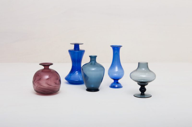 | These vintage mouth blown glass vases shine in a variety of colors and shapes. Whether individually or as an ensemble, they put small flower arrangements perfectly in scene. |