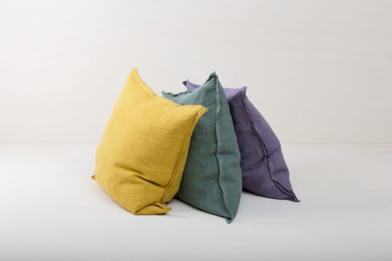 Pillow Cosme Linen Green 50x50 | Beautiful green colored cushion made of stone-washed linen. The linen fabric is pre-washed and has this modern look of stone washed linen and is also very soft. The cushions in different colours from our rental catalogue can be very well combined with each other. With the Cosme linen cushions you can decorate events, sofas or lounges in no time at all. The zipper on these linen cushions is concealed sewn, which makes each side of the linen cushions the equally decorative. We love the natural and at the same time rustic look of stone washed linen and the combination with other colours and shapes very much. | gotvintage Rental & Event Design