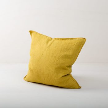 Pillow Cosme Linen Ochre 50x50 | Beautiful yellow colored cushion made of stone-washed linen. The linen fabric is pre-washed and has this modern look of stone washed linen and is also very soft. The cushions in different colours from our rental catalogue can be very well combined with each other. With the Cosme linen cushions you can decorate events, sofas or lounges in no time at all. The zipper on these linen cushions is concealed sewn, which makes each side of the linen cushions the equally decorative. We love the natural and at the same time rustic look of stone washed linen and the combination with other colours and shapes very much. | gotvintage Rental & Event Design
