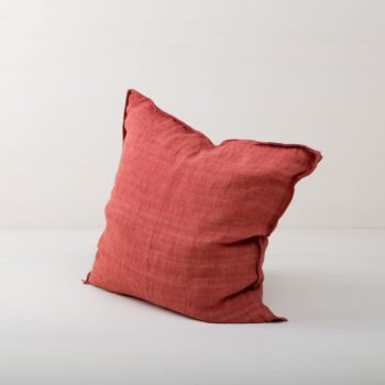 Pillow Vosme Linen Rust 50x50 | Beautiful rust colored cushion made of stone-washed linen. The linen fabric is pre-washed and has this modern look of stone washed linen and is also very soft. The cushions in different colours from our rental catalogue can be very well combined with each other. With the Cosme linen cushions you can decorate events, sofas or lounges in no time at all. The zipper on these linen cushions is concealed sewn, which makes each side of the linen cushions the equally decorative. We love the natural and at the same time rustic look of stone washed linen and the combination with other colours and shapes very much. | gotvintage Rental & Event Design