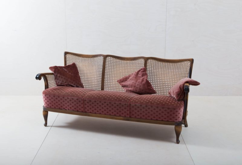 Red vintage couch with velvet cover for rent
