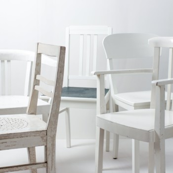 Wooden Dining Chairs Paula Vintage White Mismatching | These vintage mismatching wooden chairs beautify every long table. Through their individual shapes and designs, the different shades of white and patina results in a unique but harmonious image on their party, the wedding or at their event. Up to 300 chairs are available, so a long table can be beautifully designed. | gotvintage Rental & Event Design
