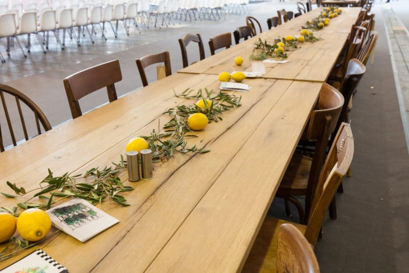 Long banquet table made of rustic wooden folding tables.