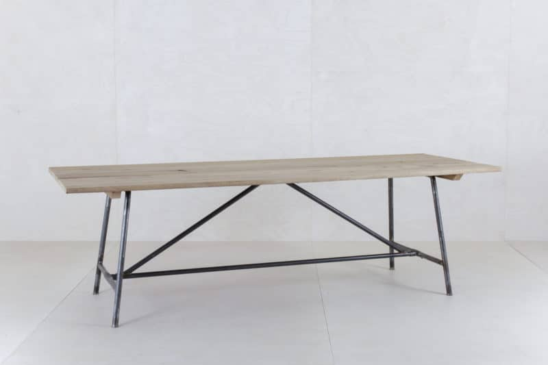 Rent a wooden folding table, almost like a beer table set, only much more beautiful.
