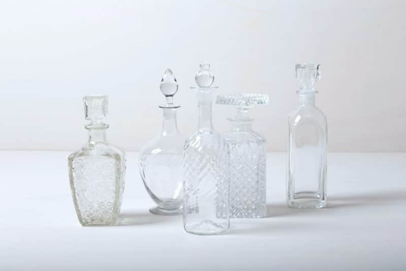 Vintage liqueur and whiskey bottles, crystal glass