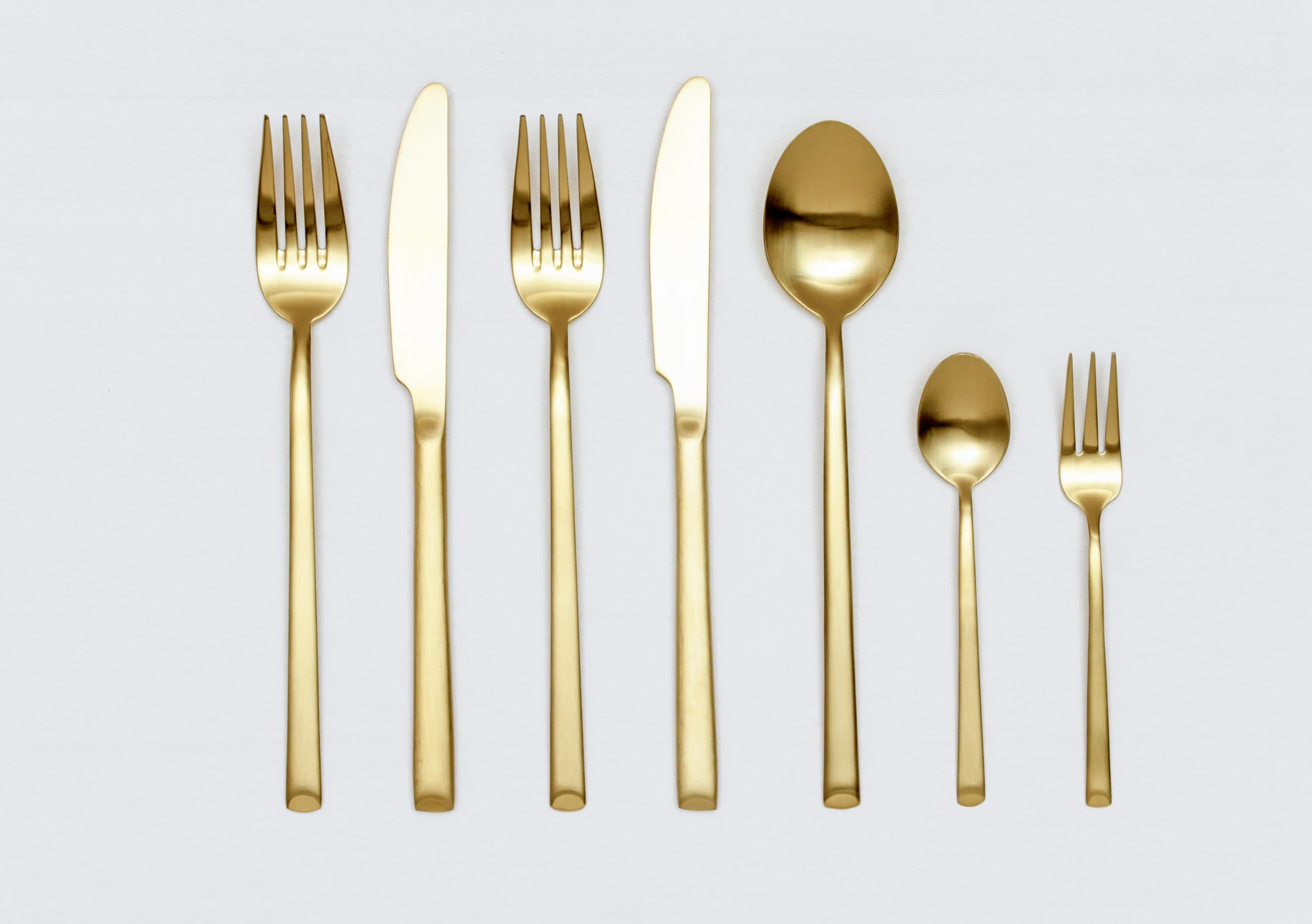 seven piece gold cutlery set