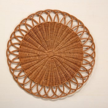 """Placemat Talapampa Rattan   Handmade from 100% rattan, these round placemats are woven in an intricate pattern that will add a special touch to any bohemian table. The natural finish accentuates the texture and pattern of the set that makes a beautiful accent to any modern table. Each piece is finished in warm brown, which highlights the texture and complexity of the weave.These placemats are the perfect base for a lovingly set table. Add our """"Vallecito"""" ceramic plates and pure linen """"Amparo"""" napkins for an organic yet sophisticated style.   gotvintage Rental & Event Design"""